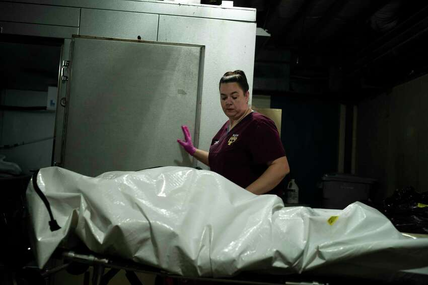 Lina Evans, the coroner of Shelby County, Ala., receives a body at the Shelby Baptist Medical Center morgue in Alabaster, April 2, 2020. Inconsistent protocols, limited resources and a patchwork of decision-making has led to an undercounting of people with the coronavirus who have died, health experts say. (Bob Miller/The New York Times)