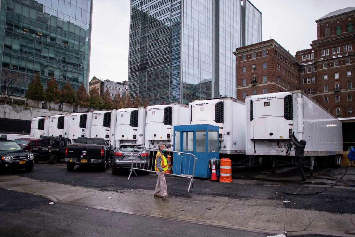 FILE - Refrigerated trucks being used as a makeshift morgue in New York, March 28, 2020. Inconsistent protocols, limited resources and a patchwork of decision-making has led to an undercounting of people with the coronavirus who have died, health experts say. (Gregg Vigliotti/The New York Times)