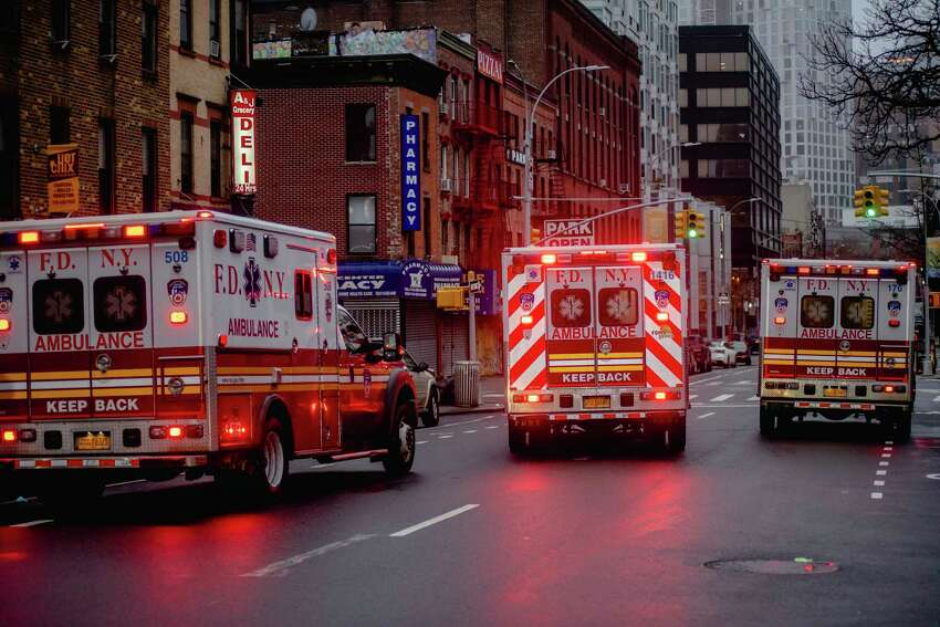 Ambulances leave the Brooklyn Hospital Center in New York, March, 29, 2020. Inconsistent protocols, limited resources and a patchwork of decision-making has led to an undercounting of people with the coronavirus who have died, health experts say. (Johnny Milano/The New York Times)