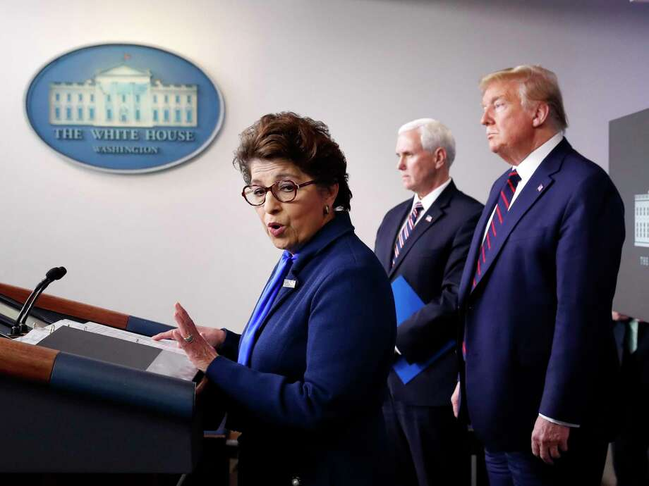 FILE - In this Thursday, April 2, 2020 file photo, Jovita Carranza, administrator of the Small Business Administration, speaks about the coronavirus in the James Brady Press Briefing Room of the White House n Washington, as Vice President Mike Pence, President Donald Trump listen. Millions of small businesses are expected to apply for a desperately needed rescue loan Friday, a stern test for a banking industry that has had less than a week to prepare for the deluge. Small businesses will be seeking loans from the $349 billion Paycheck Protection Program, which was put in place to help them retain workers and pay bills during the coronavirus pandemic. (AP Photo/Alex Brandon, File) Photo: Alex Brandon, STF / Associated Press / Copyright 2020 The Associated Press. All rights reserved.