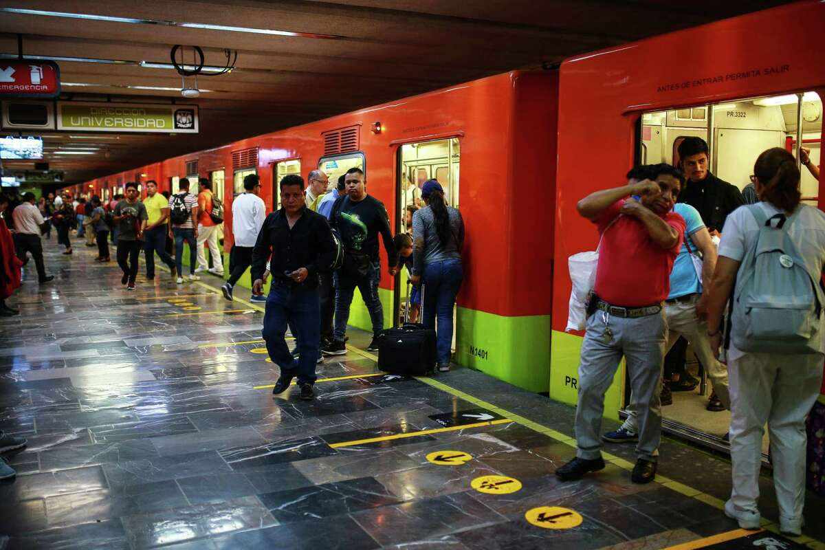 Commuters of the subway at Centro Medico Station on March 26 in Mexico City, Mexico. Mexico has moved more slowly than many other nations to impose social distancing measures.