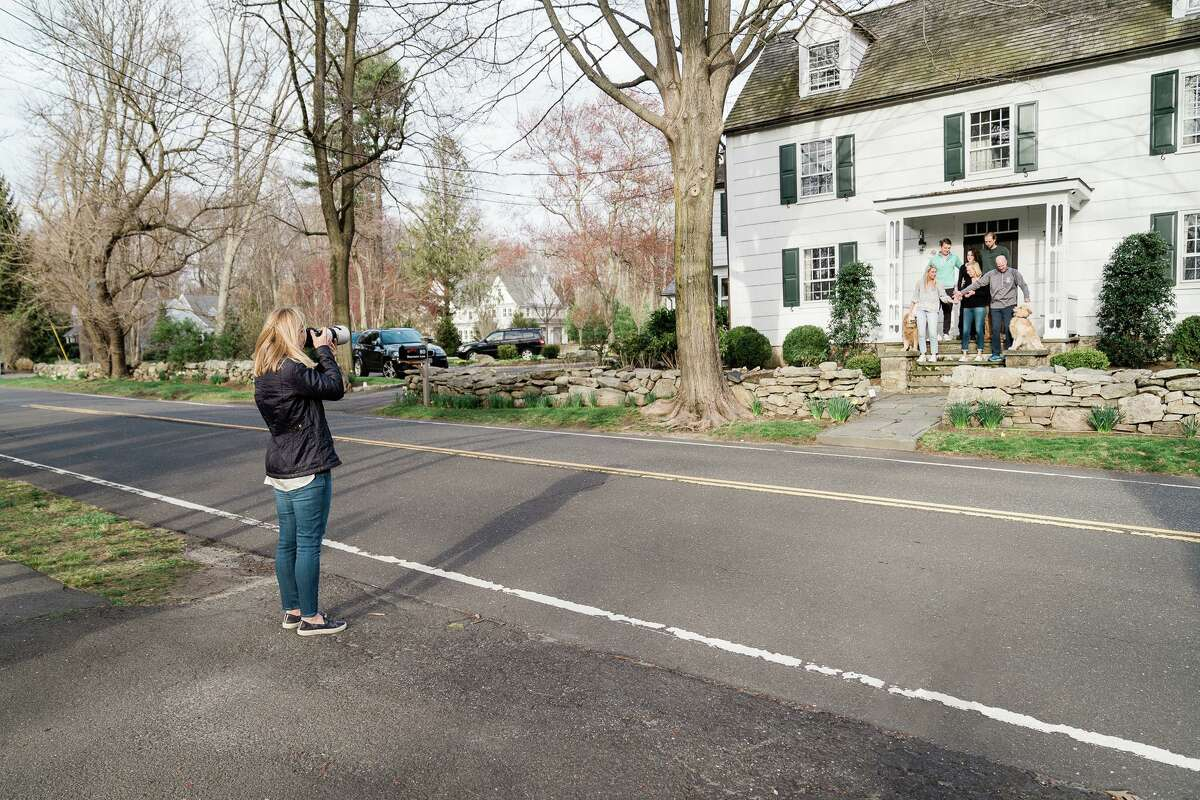 Katharine Calderwood taking photos of a Darien family.