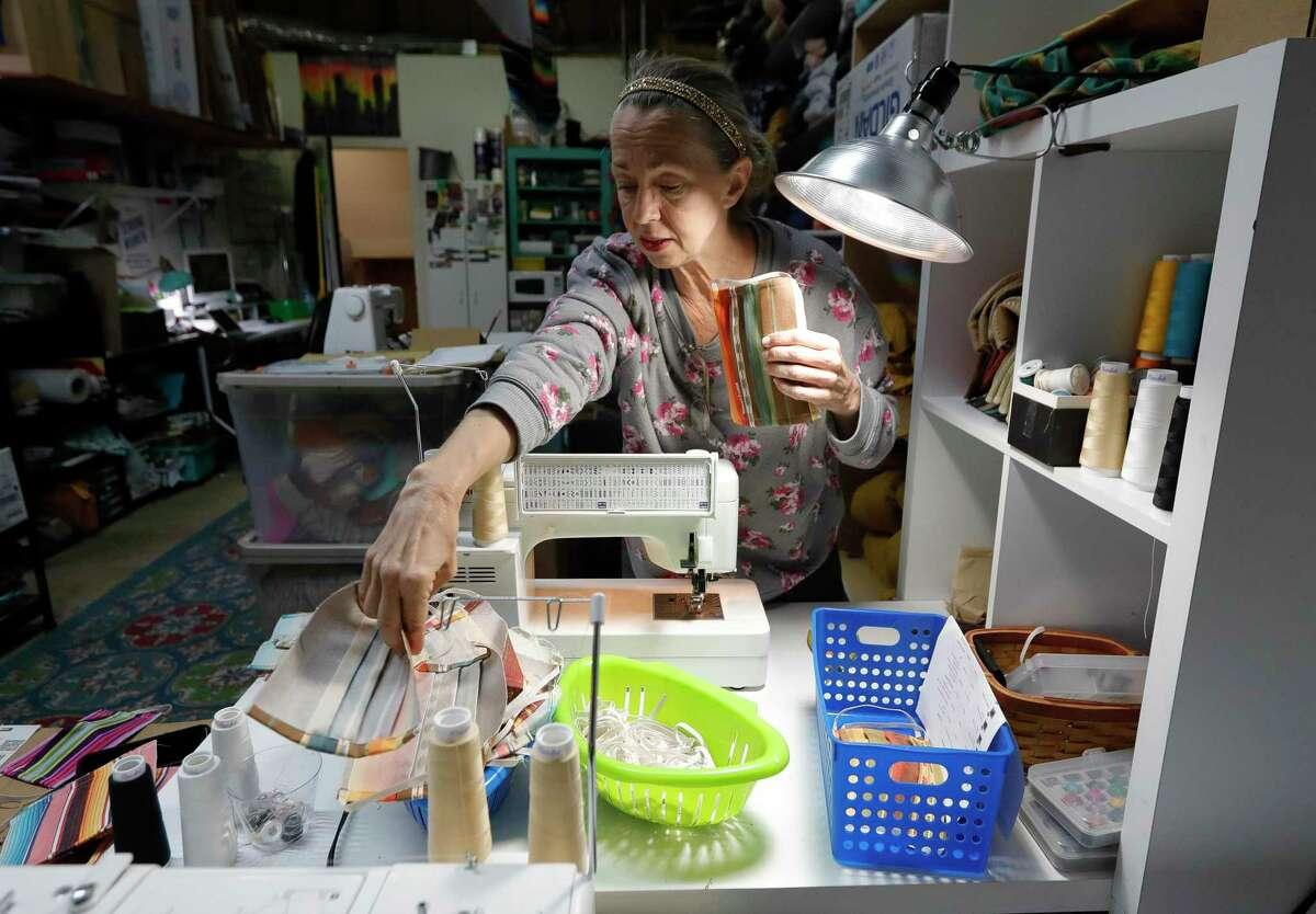 Toni Rodriguez assembles cloth masks at Sweet Texas Treasures, Saturday, April 4, 2020, in Montgomery.