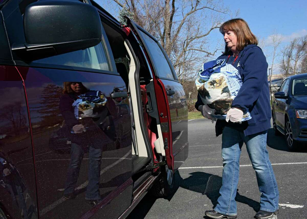 BJ Aviza, a volunteer at The Furry Friends Pet Food Pantry at the Mohawk Hudson Humane Society, is seen carrying food to her car at the shelter on Monday, April 6, 2020 in Menands, N.Y. For those who are ill or in self-isolation and live in Albany, Rensselaer or Saratoga County, the Society can deliver food. (Lori Van Buren/Times Union)