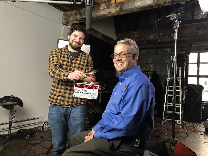 Alan Richer, right, calls himself the Toga Chip Guy, based on his knowledge of the history of the Saratoga chip. Here is Richer at a recent taping of the History Channel's