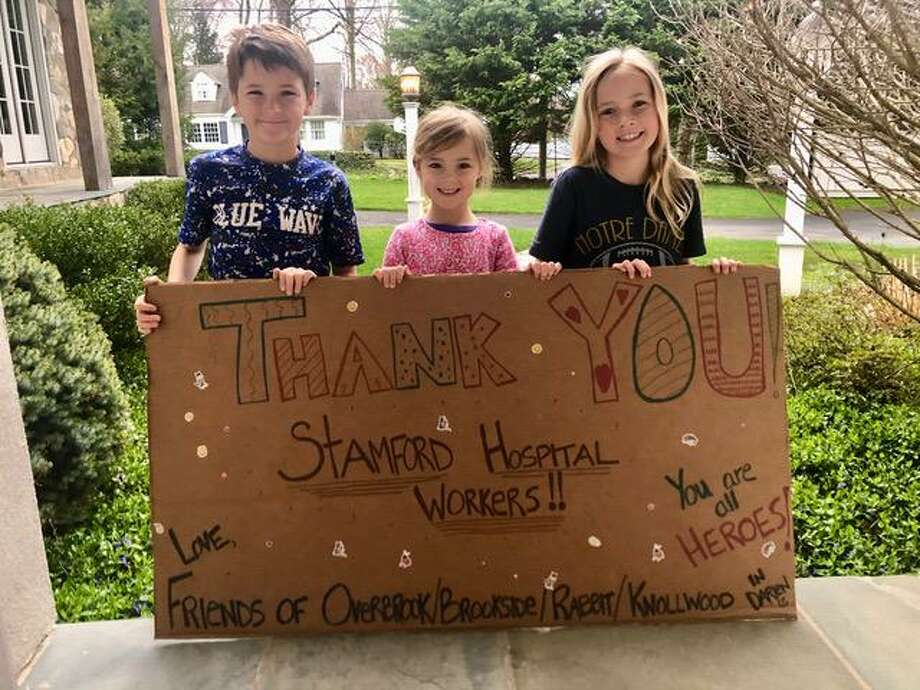Jack, Brynn and Maddie Mitchell made this poster and the hospital hung it in their halls Saturday to lift everyone's spirits. Photo: Contributed