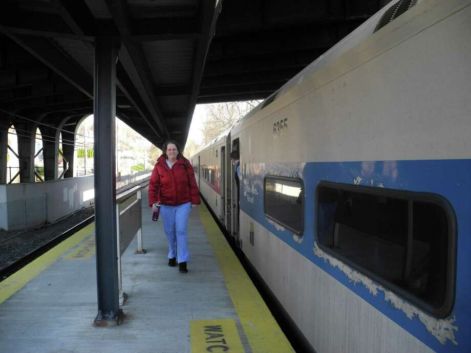 Susan Glass is the only passenger to get off the train at the Wilton station last Wednesday evening. Ridership on Metro-North has declined 90 percent since the onset of the coronavirus pandemic. Photo: Jeannette Ross / Hearst Connecticut Media / Wilton Bulletin