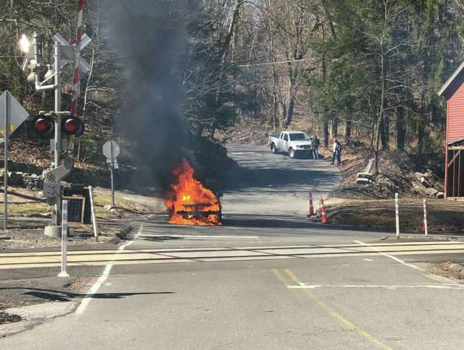 A car fully engulfed in flames near the Topstone Road and Simpaug Turnpike intersection in Redding on Saturday. Photo: Facebook / West Redding Fire Department
