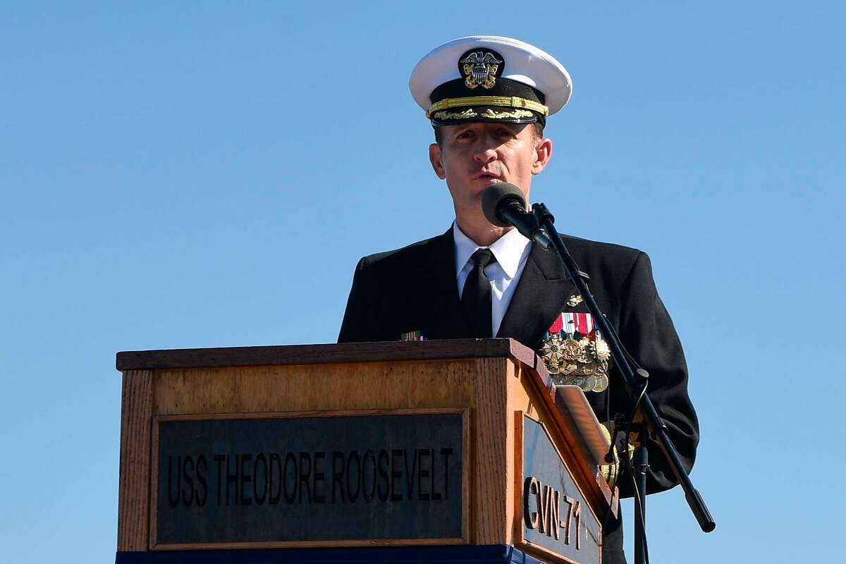 """This handout photo released by the US Navy shows Captain Brett Crozier addressing the crew for the first time as commanding officer of the aircraft carrier USS Theodore Roosevelt (CVN 71) during a change of command ceremony on the ships flight deck in San Diego, California on November 1, 2019. - The Pentagon removed the captain of the coronavirus-stricken USS Theodore Roosevelt Thursday, saying he mishandled communications over how the outbreak was sweeping through the warship. Brett Crozier """"demonstrated extremely poor judgment in the middle of a crisis"""" in writing a four-page letter detailing the problem that was leaked to the US media before top defense officials saw it, Acting Navy Secretary Thomas Modly said. (Photo by Sean LYNCH / US NAVY / AFP) / RESTRICTED TO EDITORIAL USE - MANDATORY CREDIT """"AFP PHOTO / MCS 3rd Class Sean Lynch / US NAVY """" - NO MARKETING - NO ADVERTISING CAMPAIGNS - DISTRIBUTED AS A SERVICE TO CLIENTS (Photo by SEAN LYNCH/US NAVY/AFP via Getty Images)"""