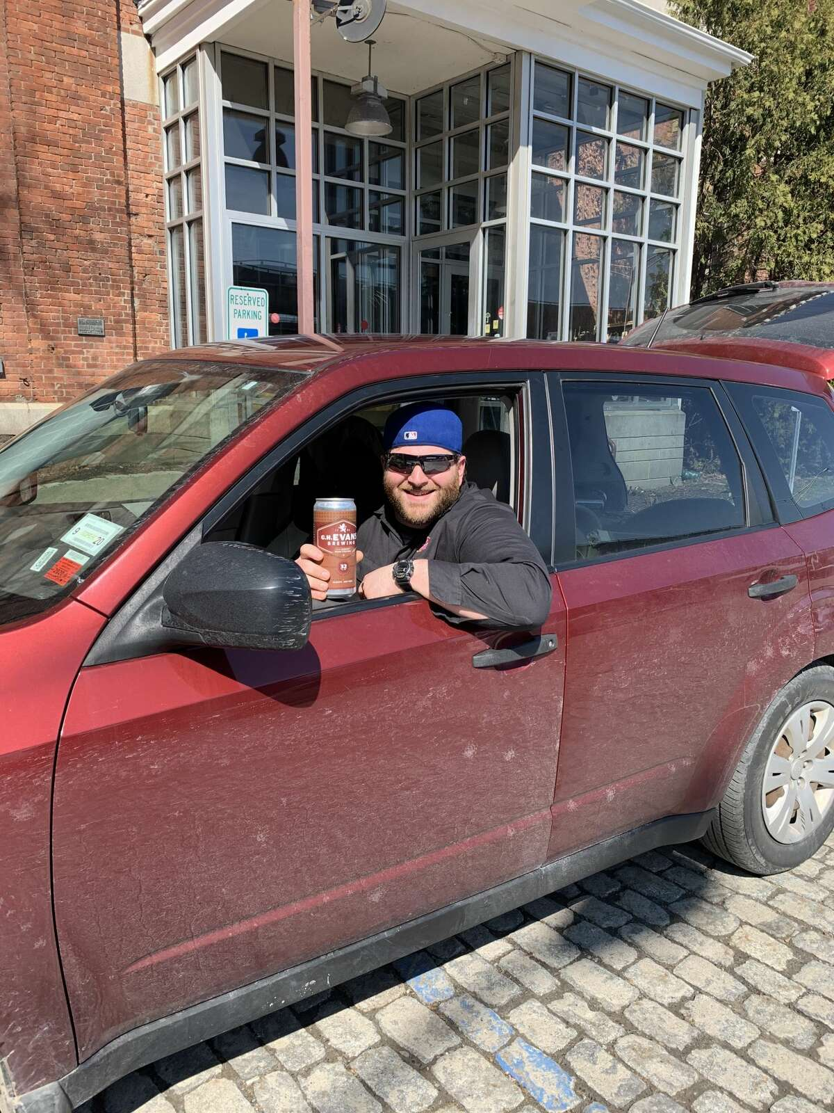 C.H. Evans' brewer, Sam Pagano, with a truck of beer deliveries to be made to customers.