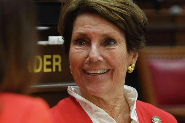 Rep. Livvy Floren, R-Greenwich, chats with a fellow legislator during opening session of the state legislature in Hartford, Conn. on Wednesday, February 05, 2020.