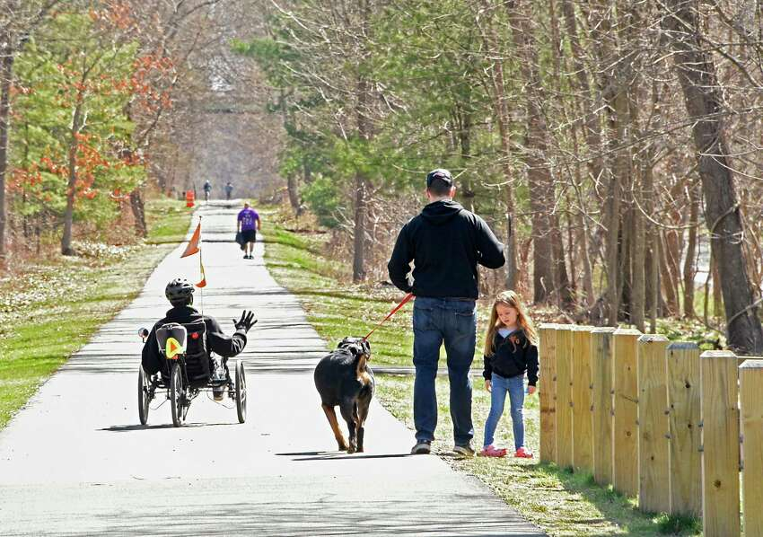 Tuesday will be another great day to get outside, Times Union meteorologist Jason Gough says but cooler temperatures - and possibly some snow - are on the way. In this photograph, pedestrians are seen walking and cycling on the Albany County Rail Trail on Monday, April 6, 2020 in Delmar, N.Y. (Lori Van Buren/Times Union)