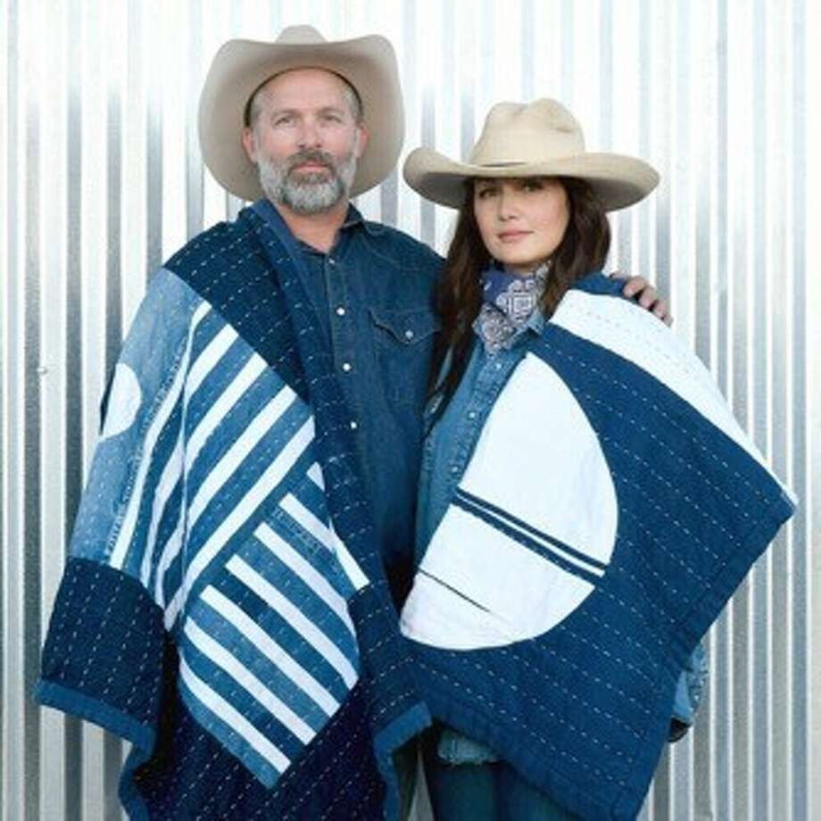 Eric and Jennie Herm are wrapped in denim blankets made from the cotton that is grown on their farm near Ackerly. The business currently is online only. The couple will be opening a shop in Marfa and have plans for shops in Houston and Santa Fe, N.M. Photo: Courtesy Photo