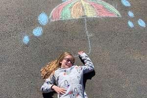 Chalk street art during the coronavirus shutdown in Orange, Conn.