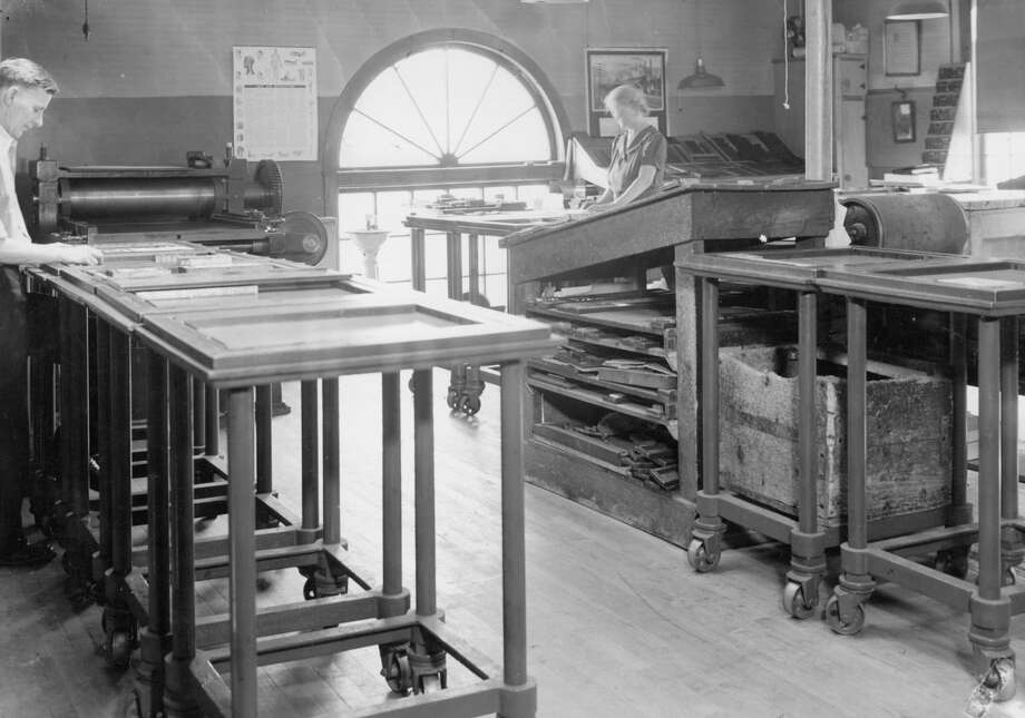 This 1940s photograph shows the inside of the Manistee News Advocate that was located on Water Street in Manistee.