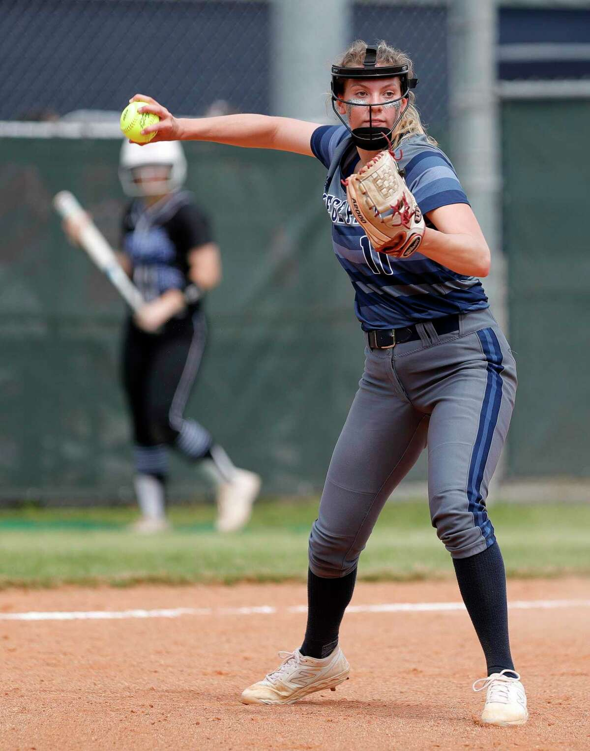 College Park starting pitcher Grace Fanset (11) fields a bunt by Emily Lyons #2 of Oak Ridge during the second inning of a District 15-6A high school softball game at College Park High School, Wednesday, March 11, 2020, in The Woodlands.