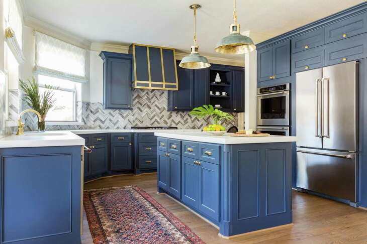 """After"" photos of the kitchen in the home of Doug Koch. Interiors by Marie Flanigan Interiors."