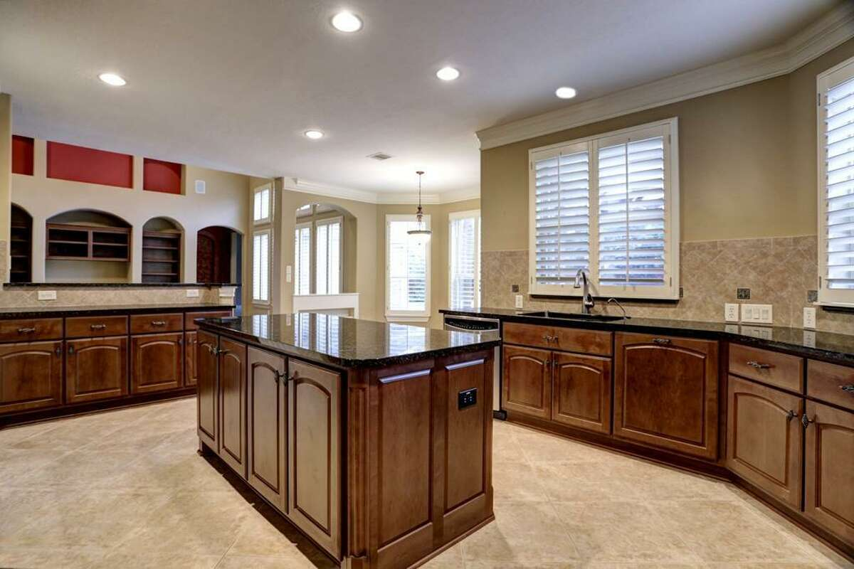 """""""Before"""" photos of the kitchen in the home of Doug Koch. Interiors by Marie Flanigan Interiors"""