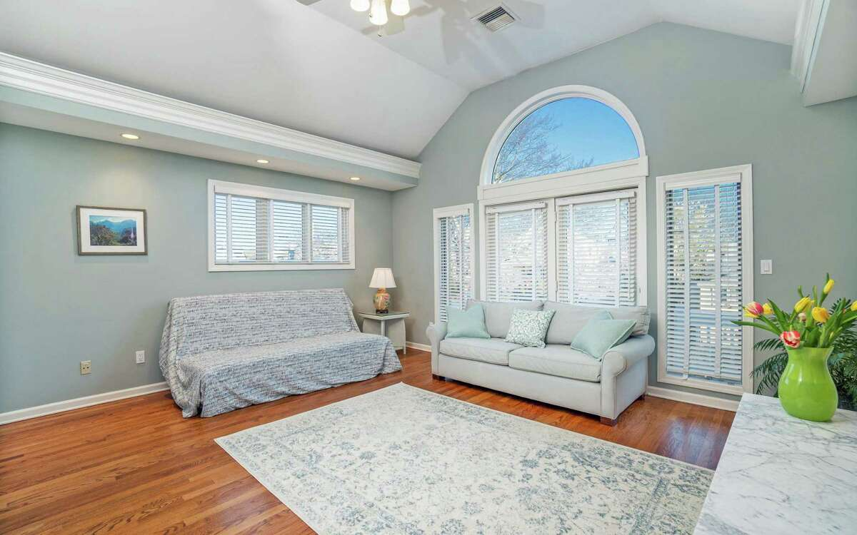 The master bedroom suite features a sitting area and French doors to the wrap-around deck/balcony (not pictured).