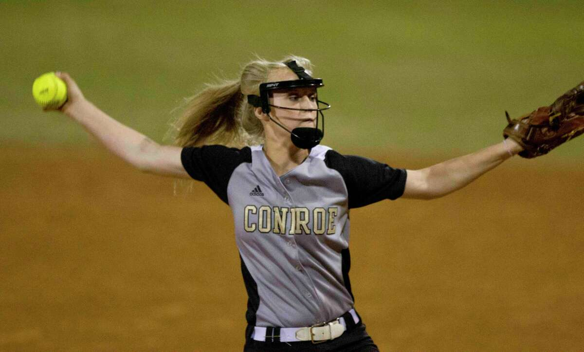 Conroe pitcher Madelyn Tannery throws in the first inning of a District 16-6A softball game at Conroe High School Tuesday. Go to HCNpics.com to purchase this photos, and other like it.