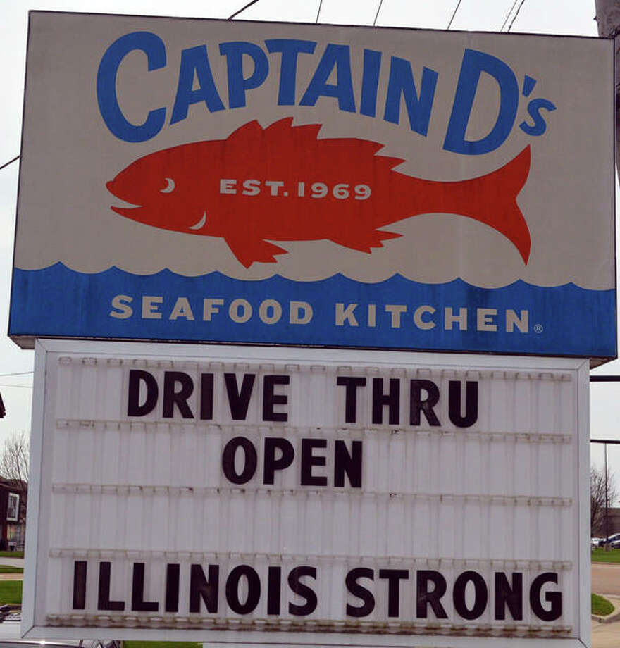 A sign at Captain D's, 1960 Troy Road in Edwardsville, sends Illinois residents that they are in this together during the COVID-19 pandemic. Photo: Scott Marion | The Intelligencer
