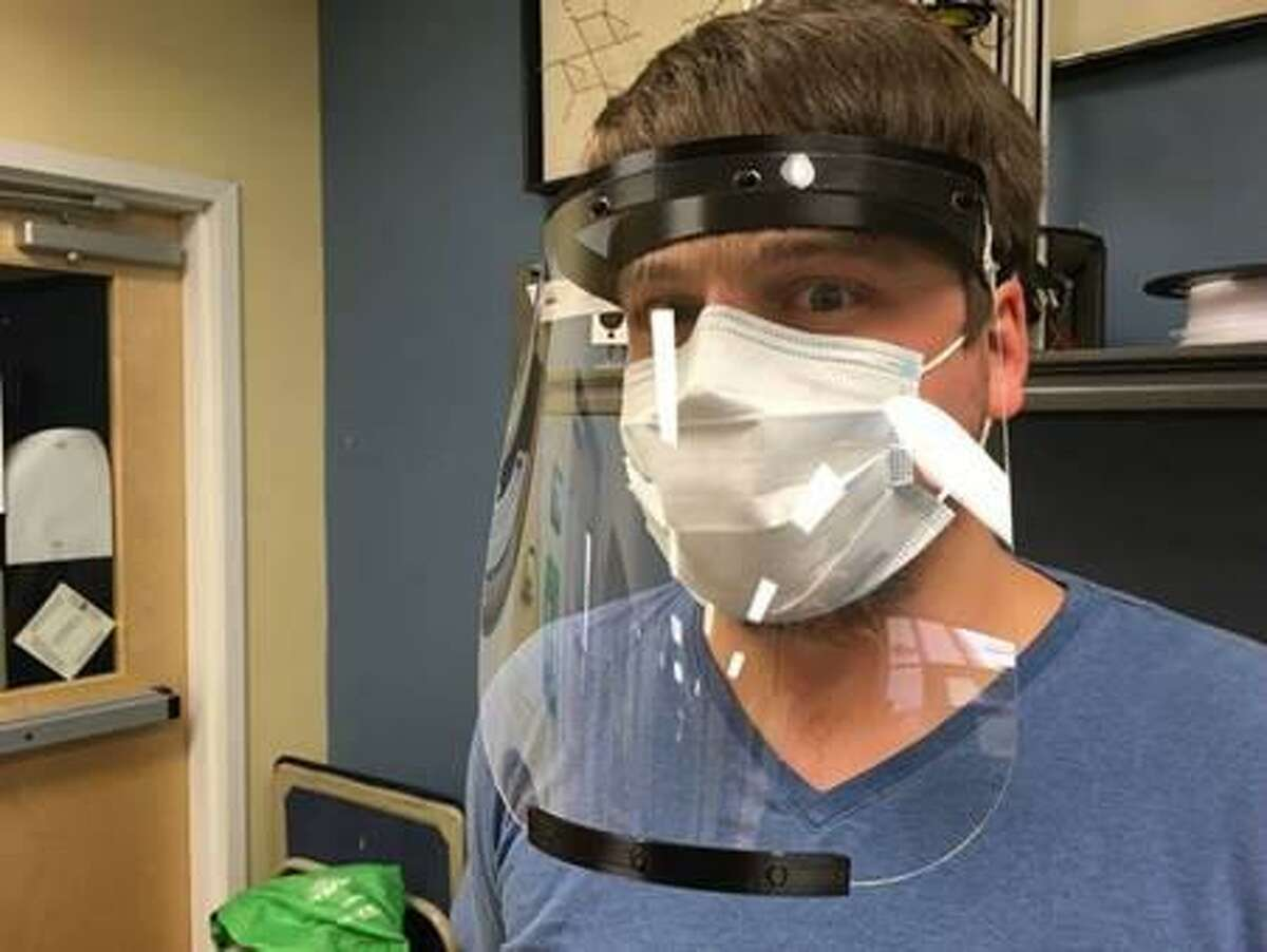 A student at Henry Abbott Technical High School in Danbury, Conn. wears a face shield produced with assistance from Danbury Hackerspace. (Photo courtesy Henry Abbott Technical High School and Danbury Hackerspace)