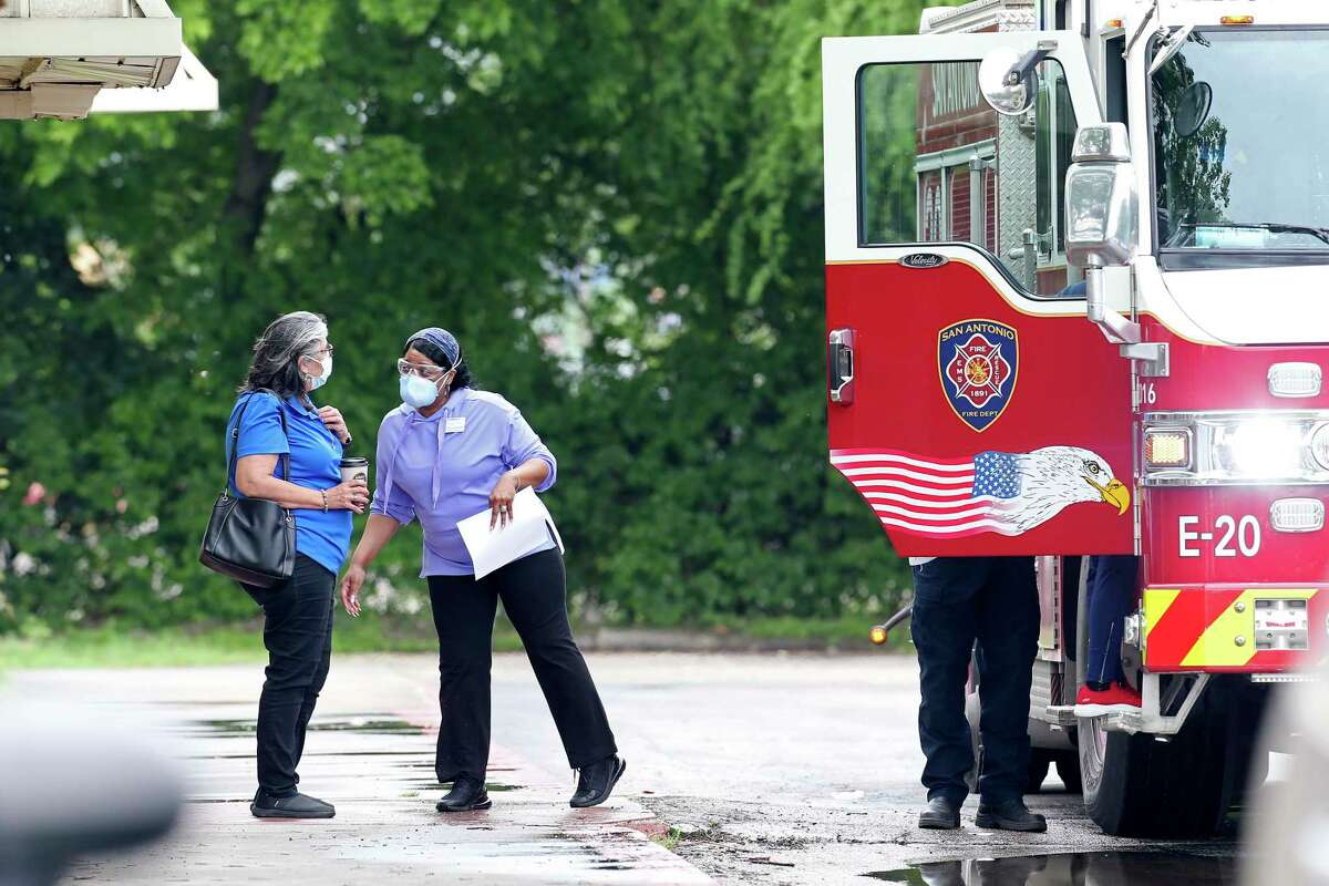 A San Antonio Fire Department truck arrives Friday at the Southeast Nursing and Rehabilitation Center, where there has been an outbreak of COVID-19, the illness caused by the new coronavirus.