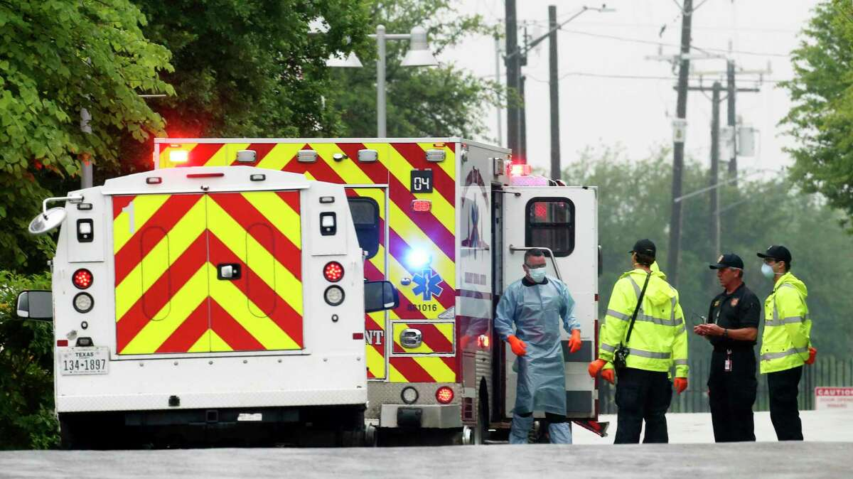 San Antonio Fire Department personnel respond to a call regarding an ill person at Haven for Hope on April 2, 2020. Due to concerns about the highly contagious coronavirus, one team member suited up in protective gear before assessing the person.