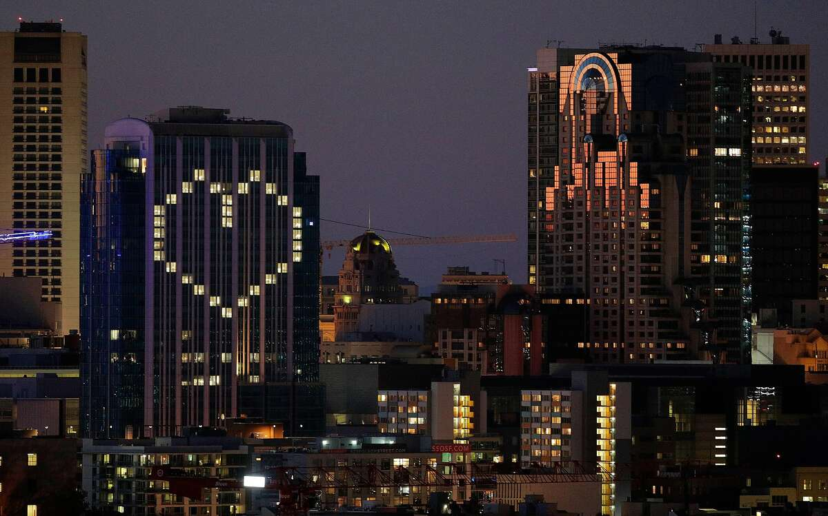 The lights on the Intercontinental Hotel are turned on in the shape of a heart in San Francisco, Calif., on Wednesday, April 1, 2020. The Intercontental joins other buildings projecting support for residents during the shelter in place to fight the spread of Covid 19.