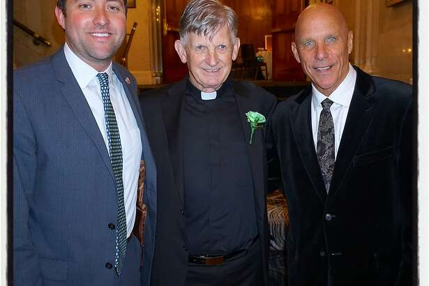 Fr. Brendan McBride (center) celebrates St. Patrick's Day with Hibernian Newman Club member Joey Nevin (left) and former SF Giants coach Tim Flannery. March 2016