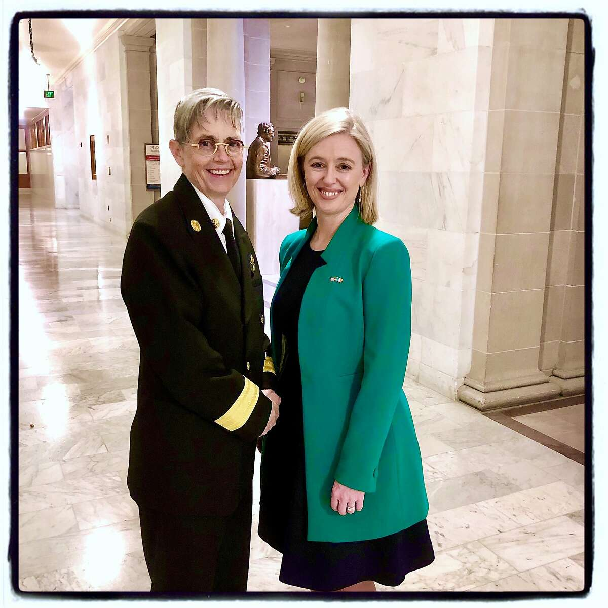 SFFD Chief Jeanine Nicholson (left) with Irish Immigration Pastoral Center Executive Director Celine Kennelly at City Hall. March 2020.