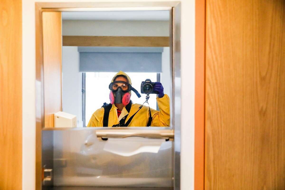 Photographer Gabrielle Lurie takes a selfie in full PPE gear on the Covid-19 floor at Saint Francis Hospital in San Francisco on Monday, April 6, 2020.