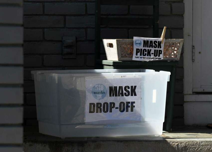 Masks are collected and distributed for the 518 Masks Facebook group at the front door of group organizer Kerri Killian-McCann's home on Monday, April 6, 2020, in Albany, N.Y. The all-volunteer group provides masks to immune-compromised people and healthcare workers. (Will Waldron/Times Union)
