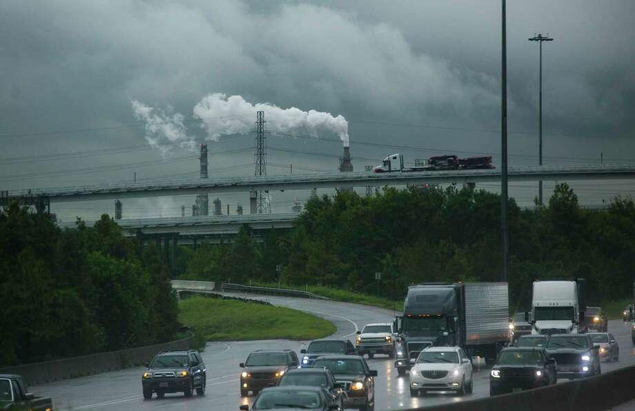 Traffic rolls down 610 East past refineries in east Houston, Tuesday, Sept. 17, 2019. Climate scientists used two different scenarios to forecast climate impacts on the Houston region, one with no change in reliance on fossil fuels, and one with a transition toward renewable energy to reduce emissions, in accord with the Paris Agreement. Many cities including Houston have signed on to independently to the Paris Agreement climate goals despite of the U.S.'s withdrawal. Photo: Mark Mulligan, Houston Chronicle / Staff Photographer / © 2019 Mark Mulligan / Houston Chronicle