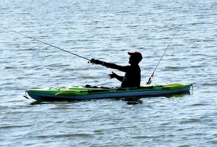 A kayaker casts his fishing line at Six Mile Waterworks on Monday, April 6, 2020 in Albany, N.Y. (Lori Van Buren/Times Union)