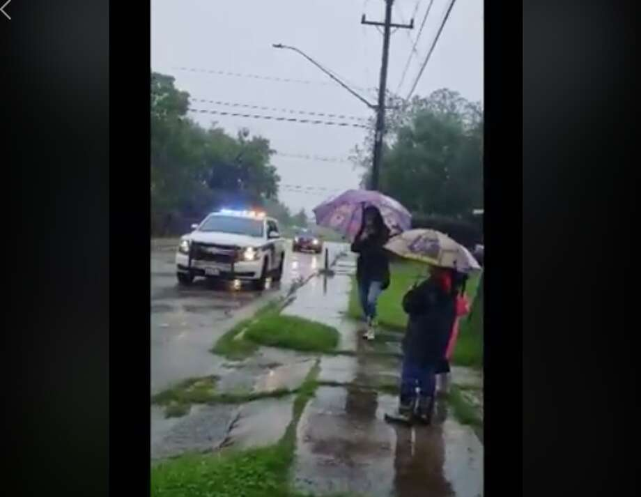 """Despite a rainy Saturday, the Bexar County Sheriff's Office brought a """"little bit of shine"""" to a 9-year-old after putting together a drive-by parade for his birthday. Photo: BCSO"""