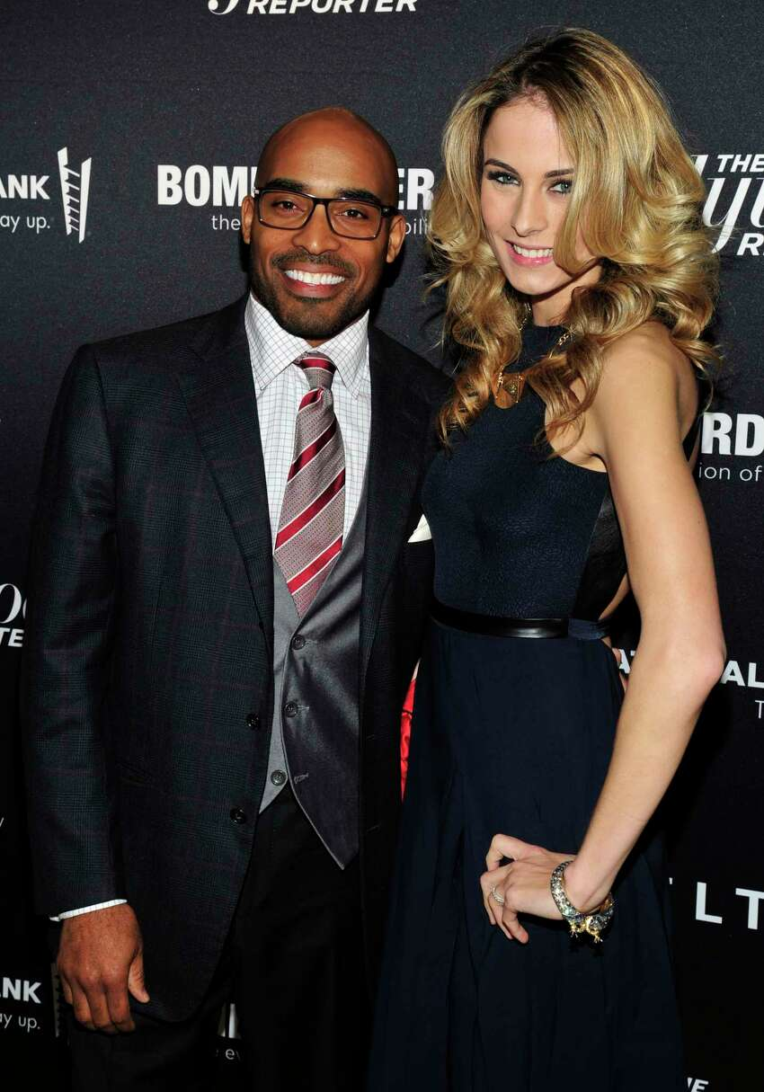 From left, Tiki Barber and Traci Lynn Johnson seen on the red carpet for The Hollywood Reporter Celebrates the 35 Most Powerful People in Media, on April 10th, 2013, in New York. (Photo by Charles Sykes/Invision for The Hollywood Reporter/AP Images)
