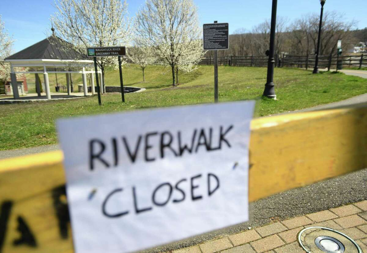 The Ansonia Riverwalk, a section of the Naugatuck River Greenway, is closed due to social distancing concerns during the coronavirus pandemic in Ansonia, Conn. on Monday, April 6, 2020.