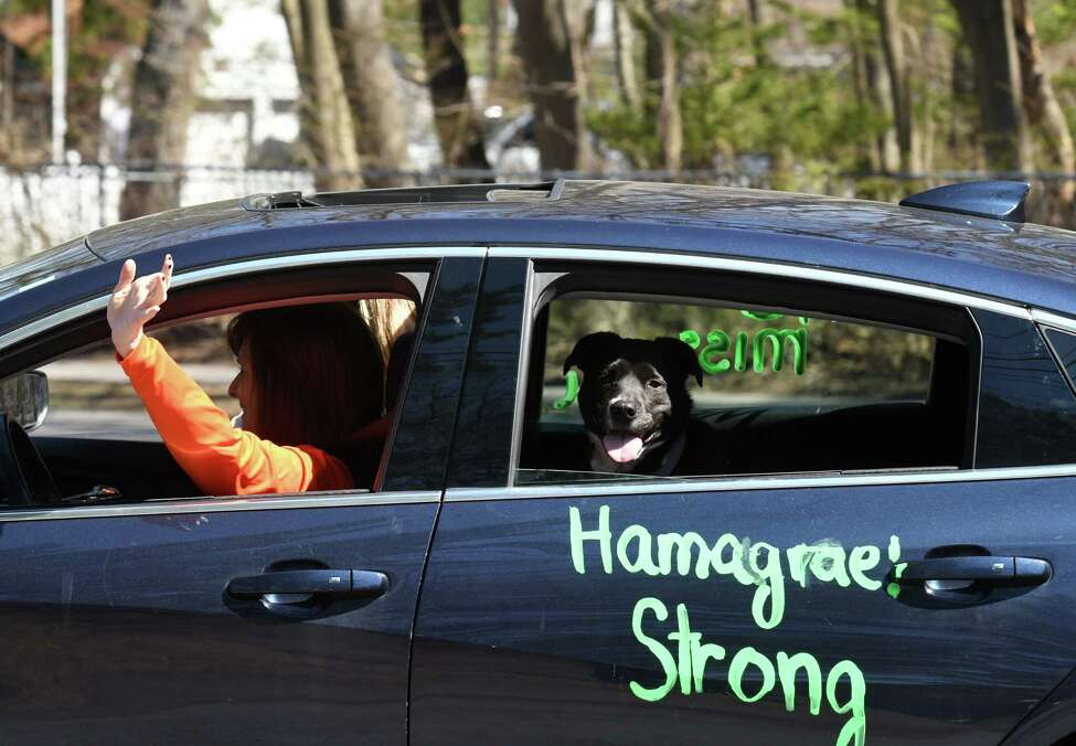 A caravan of cars parades down Winne Road during an event to reconnect Hamagrael Elementary School teachers and staff with students and family dealing with the coronavirus lockdown on Monday, April 6, 2020, in Delmar, N.Y. (Will Waldron/Times Union)