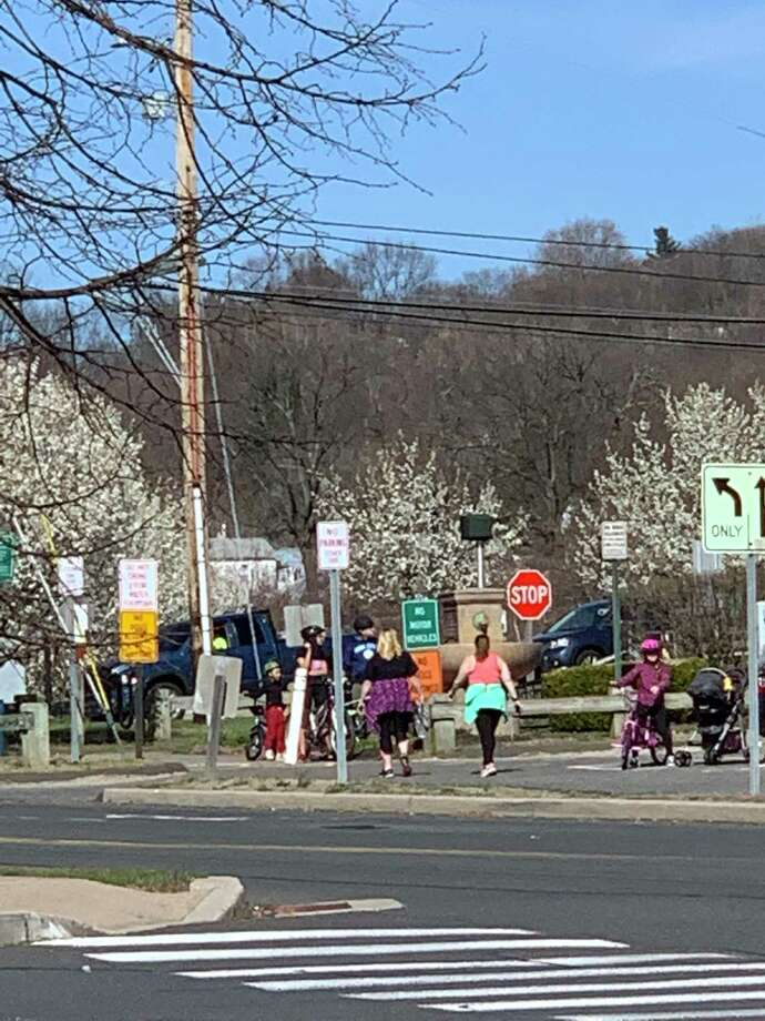 Walkers fill the Derby Greenway Monday afternoon just hours after Ansonia Mayor David Cassetti closed the Ansonia section indefinitely because people were congregating and not following the six-foot distance rule. Photo: / Kate Pagnano-Copeland