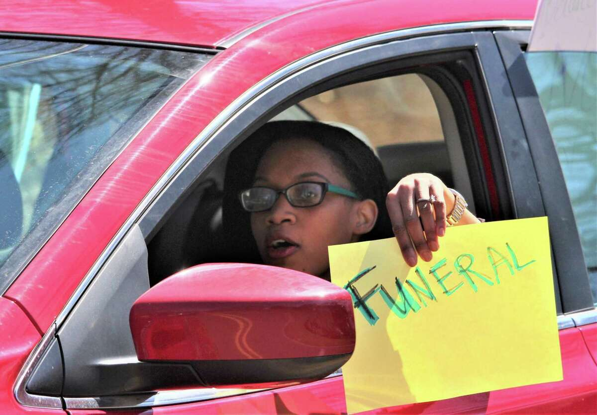 More than 50 cars gathered in front of the governor's Executive Residence in Hartford Monday, as protesters for prison release in the coronavirus crisis remained in their cars and honked, stopping traffic for about an hour.  Pictured is Rahisha Bivens, a New Haven resident originally from Bridgeport whose brother has been held at the Garner Correctional Institution in Newtown prior to a trial.