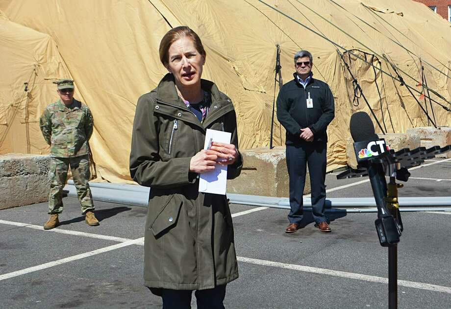 Lt Gov. Susan Bysiewicz and Maj. Gen. Francis J. Evon Jr., adjutant general of the Connecticut National Guard, speak to reporters about the 25-bed mobile unit at Middlesex Hospital in Middletown Monday afternoon. Photo: Cassandra Day / Hearst Connecticut Media