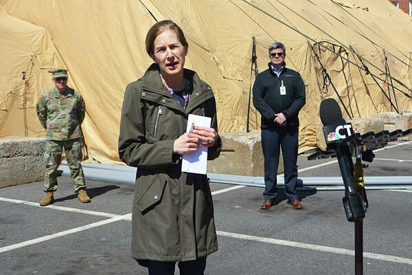 Lt Gov. Susan Bysiewicz and Maj. Gen. Francis J. Evon Jr., adjutant general of the Connecticut National Guard, speak to reporters about the 25-bed mobile unit at Middlesex Hospital in Middletown Monday afternoon.