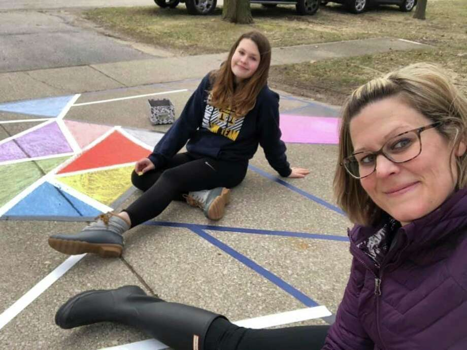 Kristen Mezeske and daughter Lauren Mezeske recently completed a piece of artwork on their Filer Township driveway that is meant to look like stained glass.(Courtesy photo)