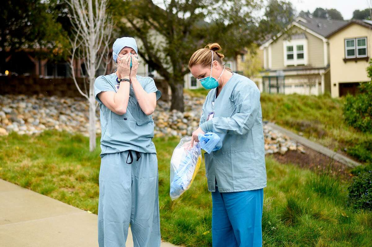 Nurses from John Muir Medical Center suit up before entering Orinda Care Center, where nearly 50 residents and staff members have tested positive for coronavirus, on Monday, April 6, 2020, in Orinda, Calif.