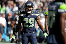 FILE - In this Sept. 23, 2018, file photo, Seattle Seahawks free safety Earl Thomas celebrates a play against the Dallas Cowboys during the first half of an NFL football game in Seattle. The Baltimore Ravens finally made their move during the NFL's free agent frenzy, securing running back Mark Ingram and safety Earl Thomas on Wednesday, March 13, 2019. (AP Photo/Elaine Thompson, File)