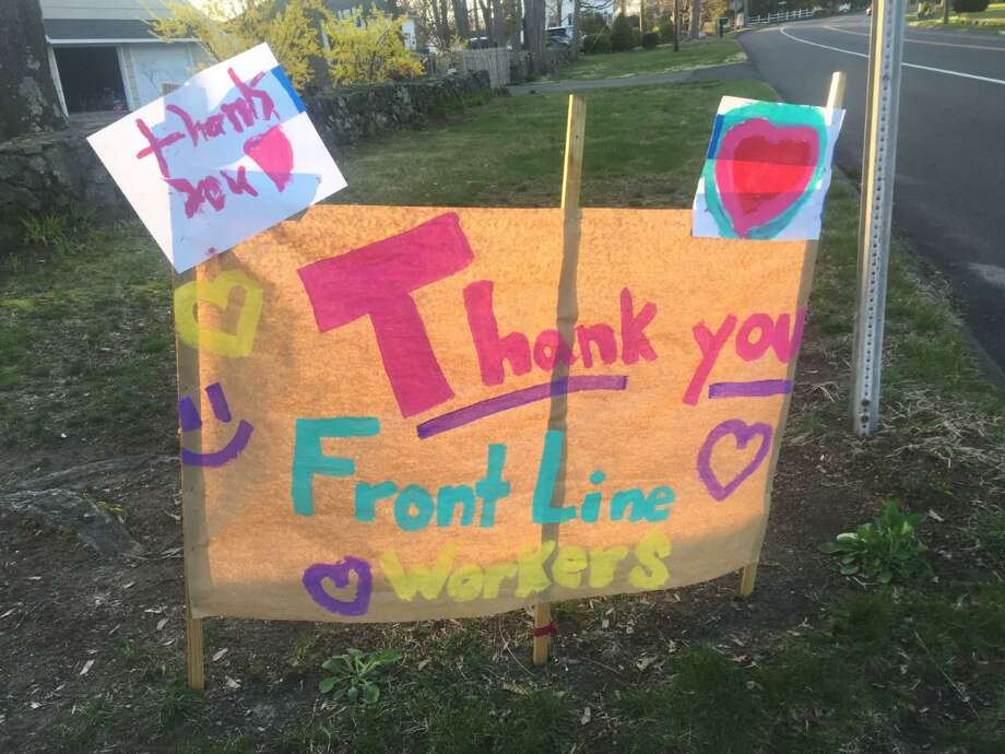 A sign is on display on the corner of Springwood Road and Main Street giving thanks to front line workers. Photo: Julie S. Miller / Hearst Connecticut Media