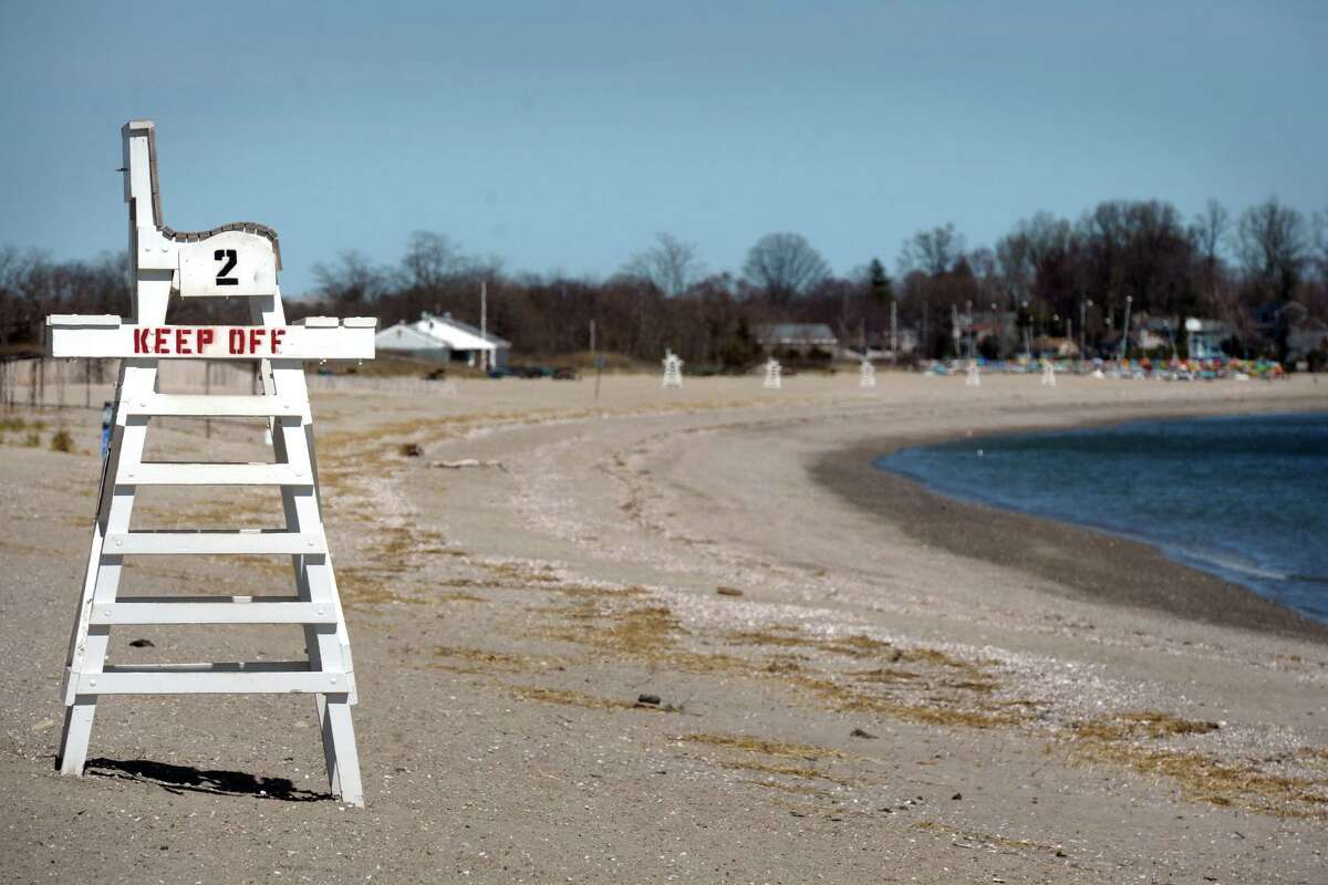 Penfield Beach, looking east towards the Fairfield Beach Club and Jennings Beach, in Fairfield, Conn. April 6, 2020. The beaches were clear of people Monday afternoon. Town of Fairfield beaches and parks are currently closed to the public due to coronavirus precautions.