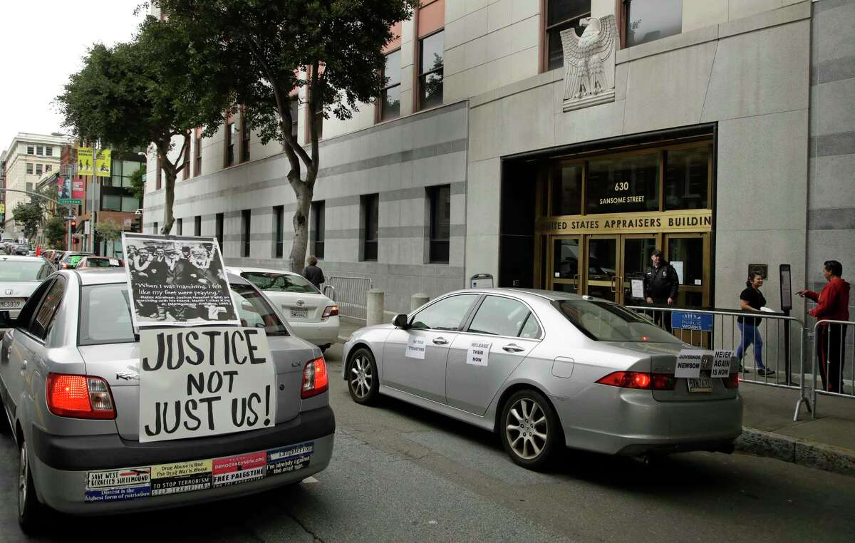 Motorists protest in vehicles to obey social distancing guidelines at a U.S. Immigration and Customs Enforcement field office on Tuesday, March 31, 2020, in San Francisco. Activists want California Gov. Newsom and local authorities to use their emergency powers to release immigrants in California detention centers. The protestors argue that mandates for social distancing and hygiene protocols in order to prevent deaths from COVID-19 are unable to be followed by what they perceive to be cramped, unsanitary conditions in ICE detention centers. (AP Photo/Ben Margot)