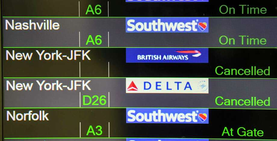A flight board at Baltimore-Washington International Marshall Airport on April 1, 2020, shows that some flights to the New York area were canceled. Photo: Jonathan Newton / The Washington Post
